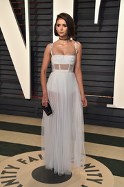 Nina Dobrev looked beguiling in a sheer white corset gown by Christian Dior at the Vanity Fair Oscar party.
