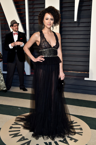 Nathalie Emmanuel looked provocative in a sheer, low-cut black gown by Monique Lhuillier at the Vanity Fair Oscar party.