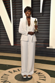 In a sea of gowns, Viola Davis stood out in her custom white Brandon Maxwell pantsuit during the Vanity Fair Oscar party.