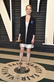 Emma Stone kept it relaxed yet elegant at the Vanity Fair Oscar party in a crystal-studded blazer layered over a slip dress, both by Givenchy.