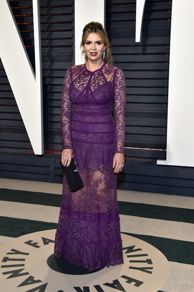 Carly Steel looked lovely in a long-sleeve purple lace gown by Elie Saab at the Vanity Fair Oscar party.