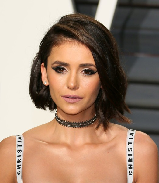 Nina Dobrev looked so sweet and pretty with her side-parted bob at the 2017 Vanity Fair Oscar party.