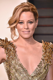 Elizabeth Banks looked gorgeous with her messy-glam updo at the Vanity Fair Oscar party.
