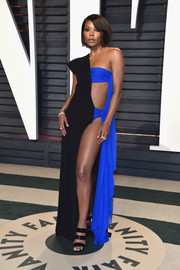 Gabrielle Union looked va-va-voom at the Vanity Fair Oscar party in a two-tone Jean Paul Gaultier Couture gown with a bodice cutout and a hip-high slit.