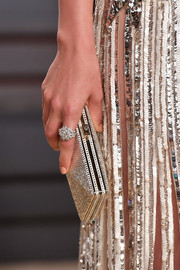 Ana de Armas accessorized with a silver clutch to match her sequined dress at the 2017 Vanity Fair Oscar party.