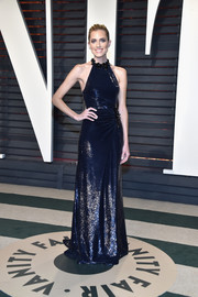 Allison Williams looked breathtaking in a fluid blue halter gown at the Vanity Fair Oscar party.