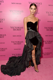 Lily Aldridge got glam in a strapless black Alexandre Vauthier Couture gown with a flowing ruffle train for the 2017 Victoria's Secret fashion show after-party.