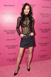 Liu Wen paired her sexy top with a charcoal denim mini skirt.