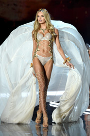 Romee Strijd's Brian Atwood thigh-high gladiator heels coordinated perfectly with her strappy lingerie!