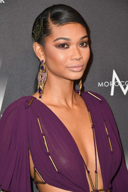 Chanel Iman accessorized with some heavy-looking gemstone earrings at the Weinstein Company Golden Globes after-party.