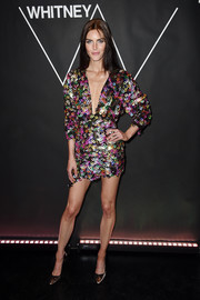 Bowed gold pumps finished off Hilary Rhoda's party-ready look.