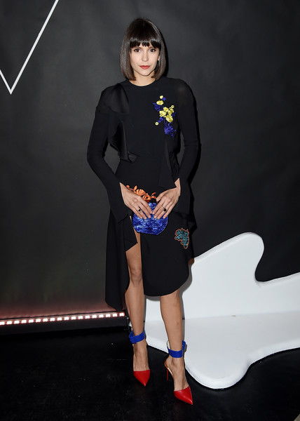 Nina Dobrev added more color with a pair of red and blue ankle-cuff pumps by Christian Louboutin.