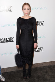 Tavi Gevinson complemented her dress with a black fur purse.