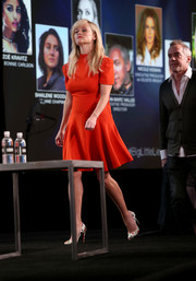 Reese Witherspoon opted for a simple red fit-and-flare dress by Alexander McQueen when she attended the 2017 Winter TCA Tour.