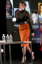 Shailene Woodley brightened up her black top with an orange suede pencil skirt, also by Bottega Veneta.