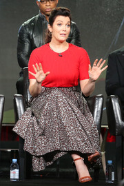 A pair of burnt-orange ankle-strap Schutz sandals completed Bellamy Young's ensemble.