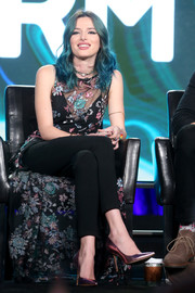 Bella Thorne teamed her dress with black skinny pants by Rag & Bone.