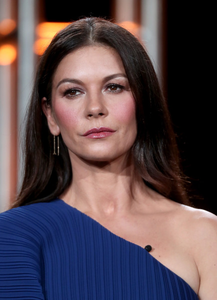 Catherine Zeta-Jones wore her hair loose with a center part when she attended the 2017 Winter TCA Tour.