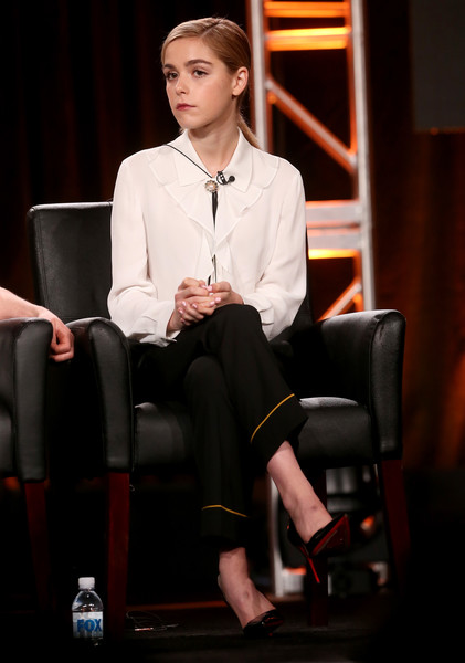 Kiernan Shipka looked very prim in a white ruffle blouse and black pants at the 2017 Winter TCA Tour.