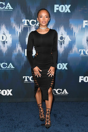 Serayah took a daring turn in a figure-hugging black Hamel dress with side cutouts at the 2017 Winter TCA Tour Fox All-Star Party.