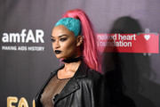 Shanina Shaik contrasted her colorful 'do with black lipstick.
