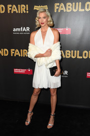 Karlie Kloss styled her dress with silver ankle-strap sandals by Gianvito Rossi.