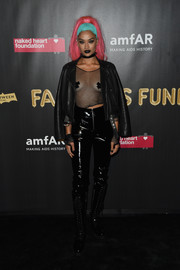 Shanina Shaik layered a black leather jacket over a fishnet top for the 2017 amfAR Fabulous Fund Fair.