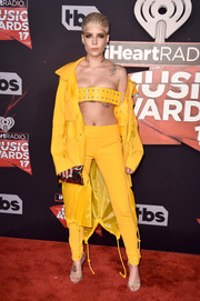 Halsey injected some shine with a gold Anya Hindmarch clutch.