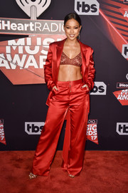 Karrueche Tran teamed a Yousef Akbar satin suit with a lacy bra for a red-hot look during the 2017 iHeartRadio Music Awards.