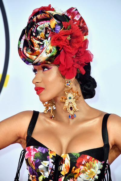 Cardi B rounded out her bold look with a massive pair of gold chandelier earrings.