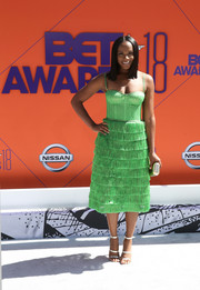 Tika Sumpter sealed off her chic look with strappy silver heels.