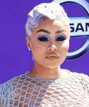 Blac Chyna attended the 2018 BET Awards wearing this silver finger wave.