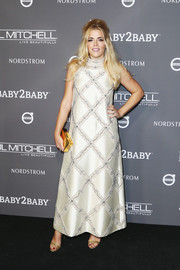 Busy Philipps was retro-glam in a beaded ivory gown by Monique Lhuillier at the 2018 Baby2Baby Gala.
