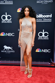 Ciara paired her slinky dress with strappy white sandals by Le Silla.