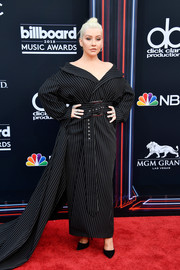 Christina Aguilera looked avant-garde in an off-the-shoulder pinstriped tuxedo gown by 16Arlington at the 2018 Billboard Music Awards.
