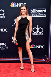 Renee Bargh sizzled in a little black halter dress with chain detail at the 2018 Billboard Music Awards.
