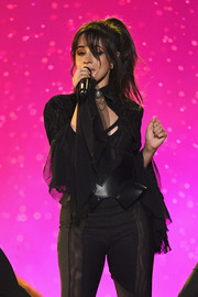 Camila Cabello accessorized her jumpsuit with an oversized black belt for her performance at the 2018 Billboard Music Awards.