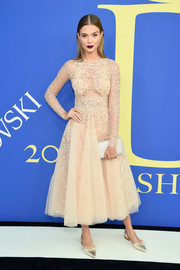 Josephine Skriver rounded out her enchanting look with a beaded silver clutch.