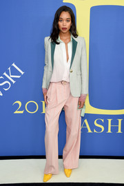 Laura Harrier went the menswear-chic route in a mint-green and pink suit by Sies Marjan at the 2018 CFDA Fashion Awards.