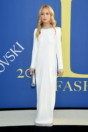 Rachel Zoe looked simply divine at the 2018 CFDA Fashion Awards in a long-sleeve white column dress with an embellished neckline, cuffs, and hem.