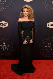 Tori Kelly looked sultry in a black off-the-shoulder gown with sheer waist and sleeve panels at the 2018 CMT Artists of the Year event.