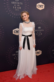 Kelsea Ballerini looked like a sweet bride in this high-neck Swiss-dot lace gown by Monique Lhuillier at the 2018 CMT Artists of the Year event.