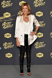 Hoda Kotb topped off her edgy-chic outfit with a white satin blazer.