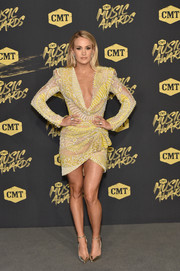 Carrie Underwood paired her frock with gold ankle-strap pumps.
