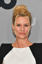 Nicollette Sheridan styled her hair into a poofy bun for the 2018 CW Network Upfront.