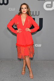 Elizabeth Gillies was a knockout in a red cocktail dress with a plunging neckline and lace detailing at the 2018 CW Network Upfront.