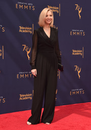 Lisa Kudrow donned a black tuxedo jumpsuit with sheer sleeves for the 2018 Creative Arts Emmy Awards.