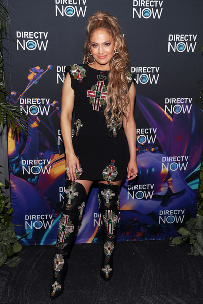 Jennifer Lopez went matchy-matchy with this embellished thigh-high boots and mini dress combo by Versace.