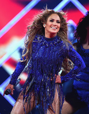 Jennifer Lopez looked totally dazzling in a fringed, Swarovski crystal-embellished bodysuit by Giannina Azar while performing at the 2018 DirecTV Now Super Saturday Night concert.
