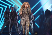 Jennifer Lopez layered a leopard-print biker jacket over a matching catsuit for her performance at the 2018 DirecTV Now Super Saturday Night concert.